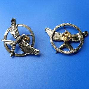 brass Hungry Games 3 lapel pin