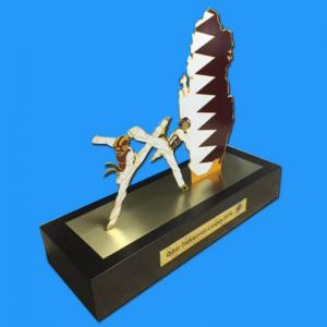 Qatar gold trophy with wooden base