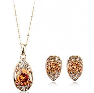 gold jewelry set with crystal